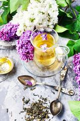 Fototapete - Tea with lilac flavor