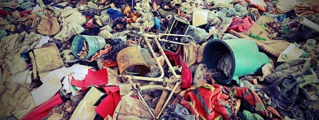 unauthorized junkyard with many abandoned objects