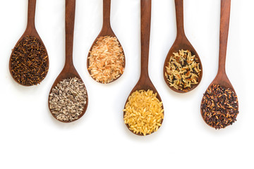 Wall Murals Herbs 2 Organic rice in wooden spoon, Mixed rice and Rice texture for background