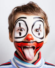 little cute real boy with facepaint like clown, pantomimic expre
