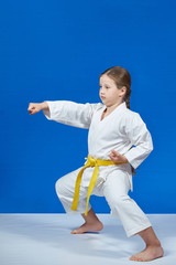 The girl is beating blow hand in the rack of karate