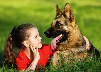 little girl and dog together