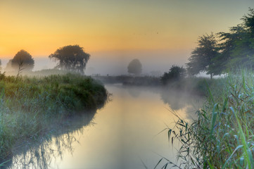First light on a misty Umzimkulwana river in the drakensberg foothills, Underberg, Kwazulu Natal, South Africa