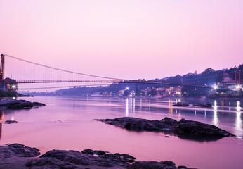 View of River Ganga and Ram Jhula bridge silhouette  Rishikesh. India.