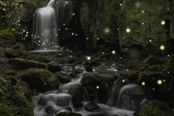 Beautiful fantasy image of fireflies over stream in rocky canyon landscape at dusk Wall mural