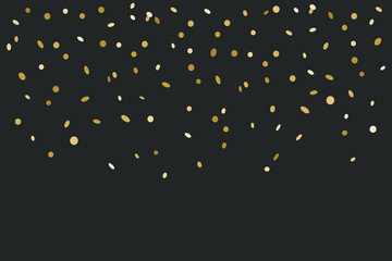 Golden confetti isolated on black background
