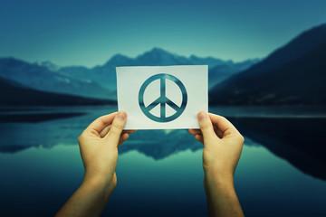 holding peace symbol