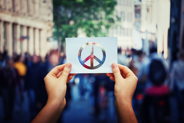 holding peace symbol