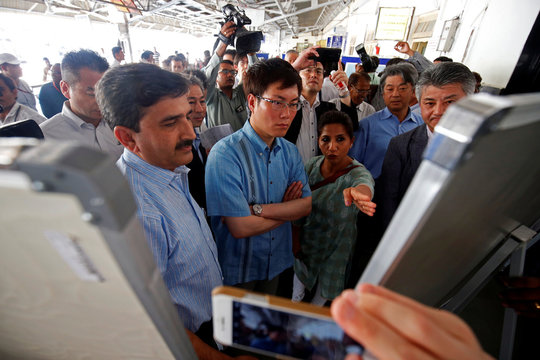 Masatoshi Akimoto, Japanese Parliamentary Vice-Minister of Land, Infrastructure, Transport and Tourism, looks at the route maps of Ahmedabad Metro Rail Project site and Mumbai Ahmedabad High Speed Rail site, at Kalupur Railway Station in Ahmedabad