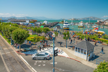 Wall Mural - SAN FRANCISCO - AUGUST 7, 2017: City port aerial view in Fisherman's Wharf. The city attracts 20 million people annually