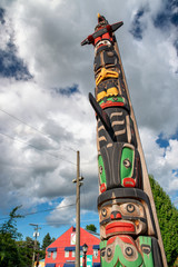 DUNCAN, CANADA - AUGUST 13, 2017: City totems against blue sky. Duncan is famous across the country for its totems