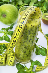 kiwi, apple and vegetable smoothie. diet and slimming concept