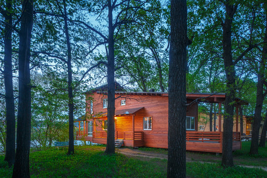 wooden cottage in forest near lake, cabin on lake