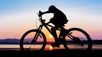 People cycling at the beach twilight time