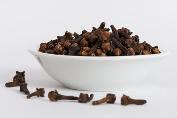 Whole Cloves in a white bowl