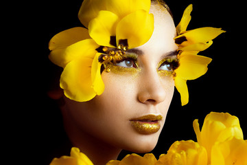 Beauty portrait of a brunette with extended eyelashes in the image of a tulip.