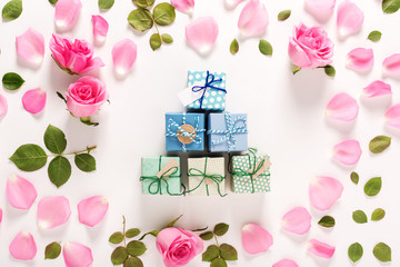 Roses and present boxes top view flat lay