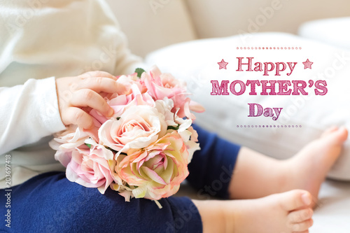 Mother's Day message with toddler boy with flowers on a couch