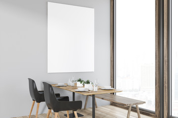 Panoramic cafe with wooden table and poster