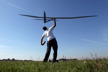 Man launches into the sky RC glider, wide-angle. F3J Model Gliders. Professional player and a competitor.