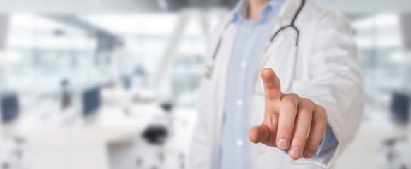 Doctor touching virtual interface with his finger