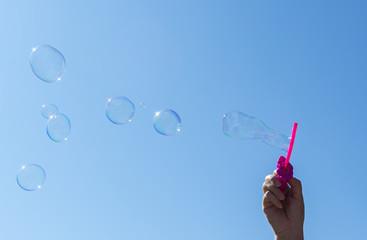 Soap bubbles, Blowing soap bubble on Blue sky background