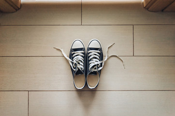 Sneakers with loosened laces. Take off your shoes. Etiquette