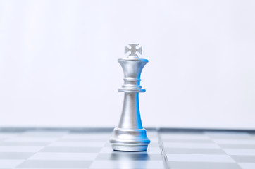 Conceptual photo of a single chess piece on a chessboard. Business, law or political concept. Selective focus.