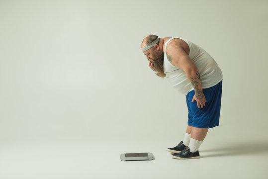 Man staring at a scale