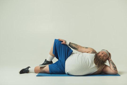 Man relaxing on a yoga mat