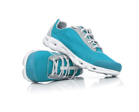 Blue sneakers isolated.