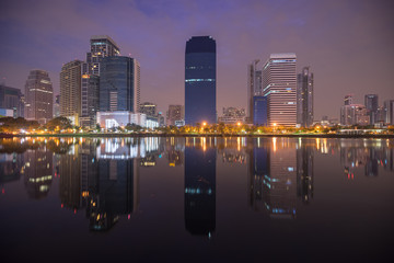 scenic of early twilight morning cityscape and mirror on water