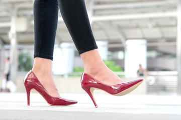 leg of woman beauty put on red high heels Walk on the street