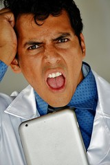 Adult Male Doctor With Tablet And Stress