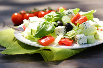 Greek salad with cheese, tomatoes and olives