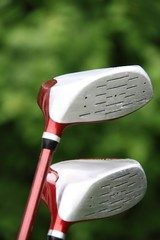 golf clubs with green background