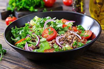 Buckwheat salad with cherry tomatoes, red onion and fresh herbs. Vegan food. Diet menu.