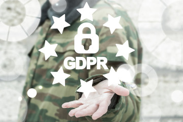 GDPR - General Data Protection Regulations Military concept. Soldier offers a padlock with gdpr word surrounded stars. European Data Security System.