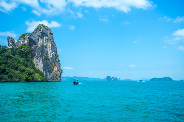 Longtail boats in the sea near Hong island in Krabi Province Thailand.