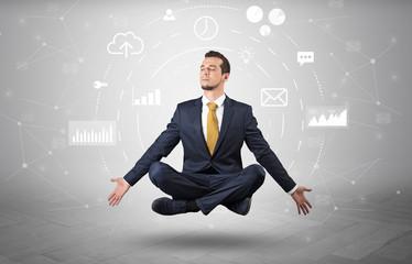 Elegant calm businessman levitates in yoga position with data circulation concept