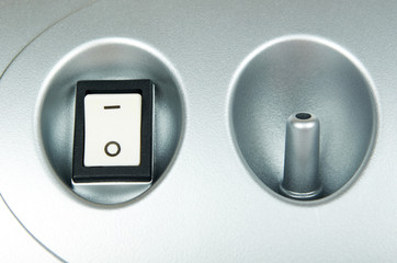 White power switch button on grey device