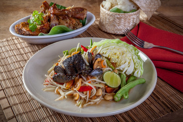 Som tam and chicken grilled rice. Thai food