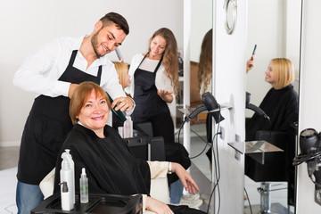 Mature woman in the barbershop.