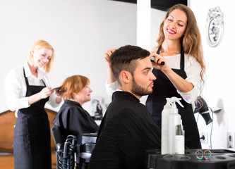 Hairdressers and clients in salon