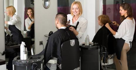 Hairdressers working in barbershop