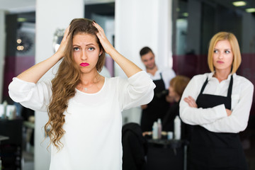 Woman client dissatisfied haircut