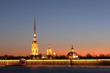 Peter and Paul Fortress of St. Petersburg, Russia in the rays of setting sun. The Peter and Paul Fortress is the original citadel  founded by Peter the Great in 1703 and built to Trezzini's designs