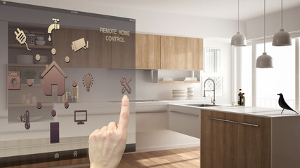 Smart home control concept, hand controlling digital interface from mobile app. Blurred background showing modern kitchen, architecture interior design