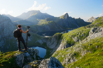 Foto auf Gartenposter Gebirge Woman photographer looking at Munkebu mountains in Lofoten