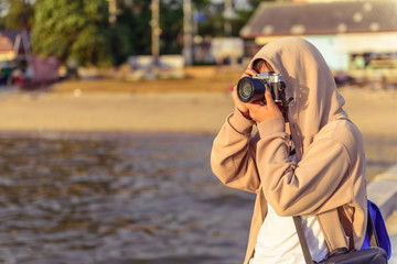 The girl use camera with vintage style.